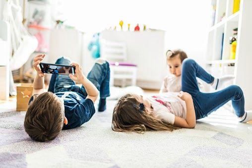Children playing on the bedroom floor