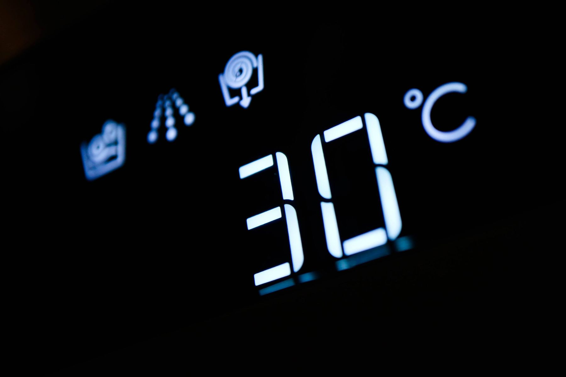 30C showing on a washing machine's digital display