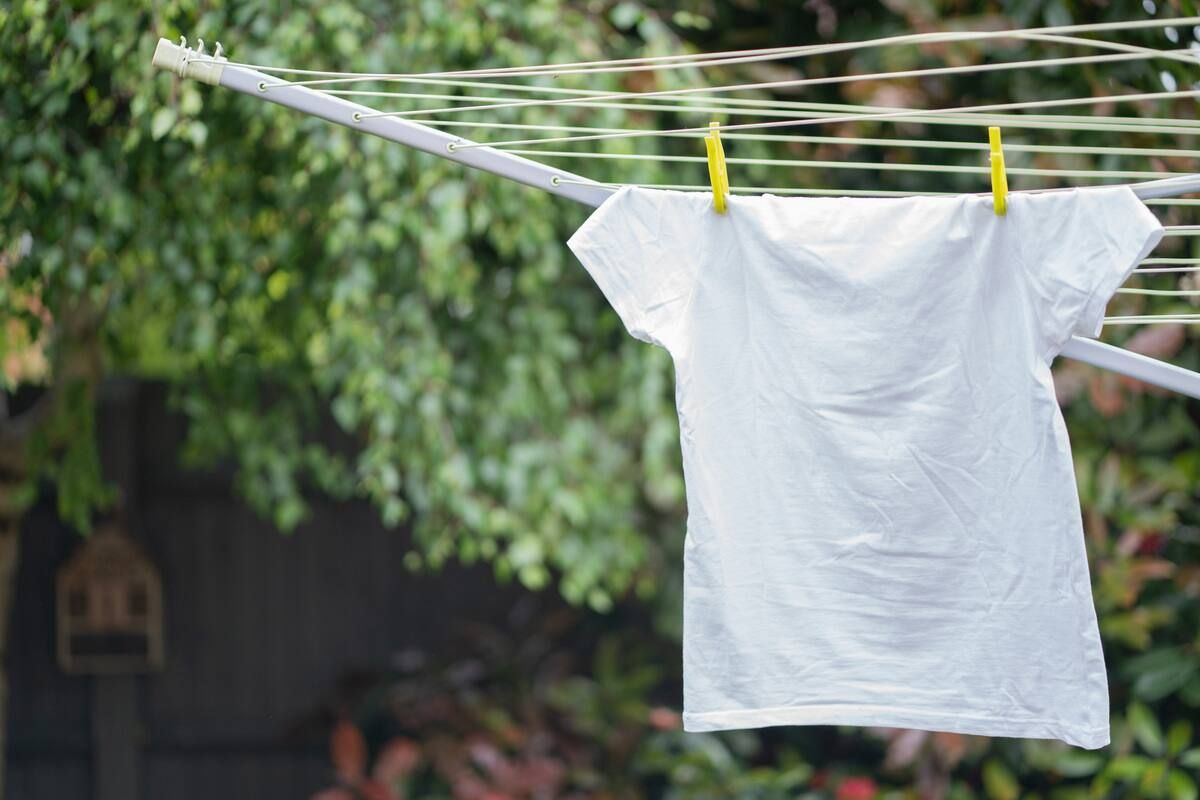 Line drying a white T-shirt outside