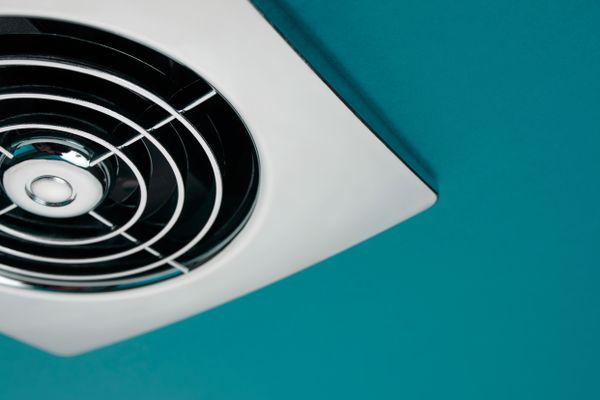 10 ways to reduce pollution: silver extractor fan in teal ceiling