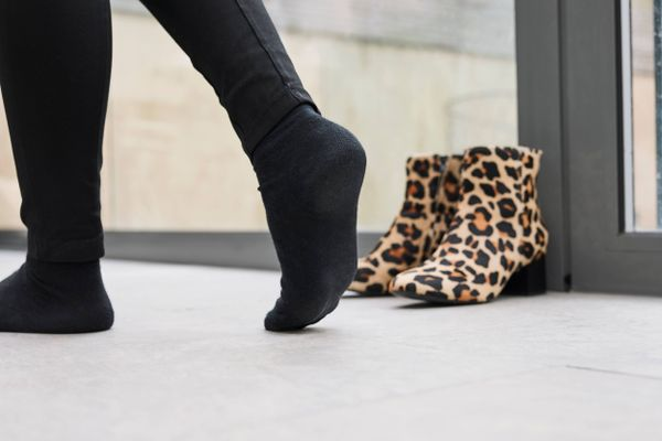 animal print boots by the window