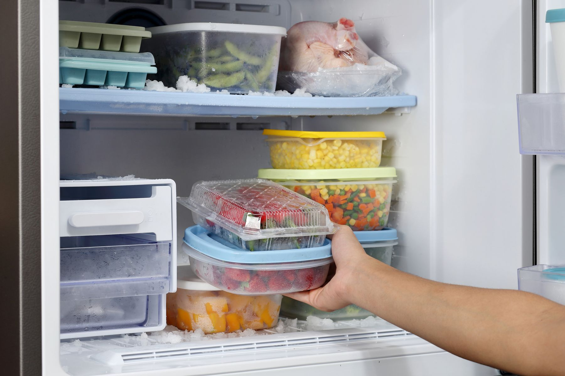 Step 2: person removing food from fridge