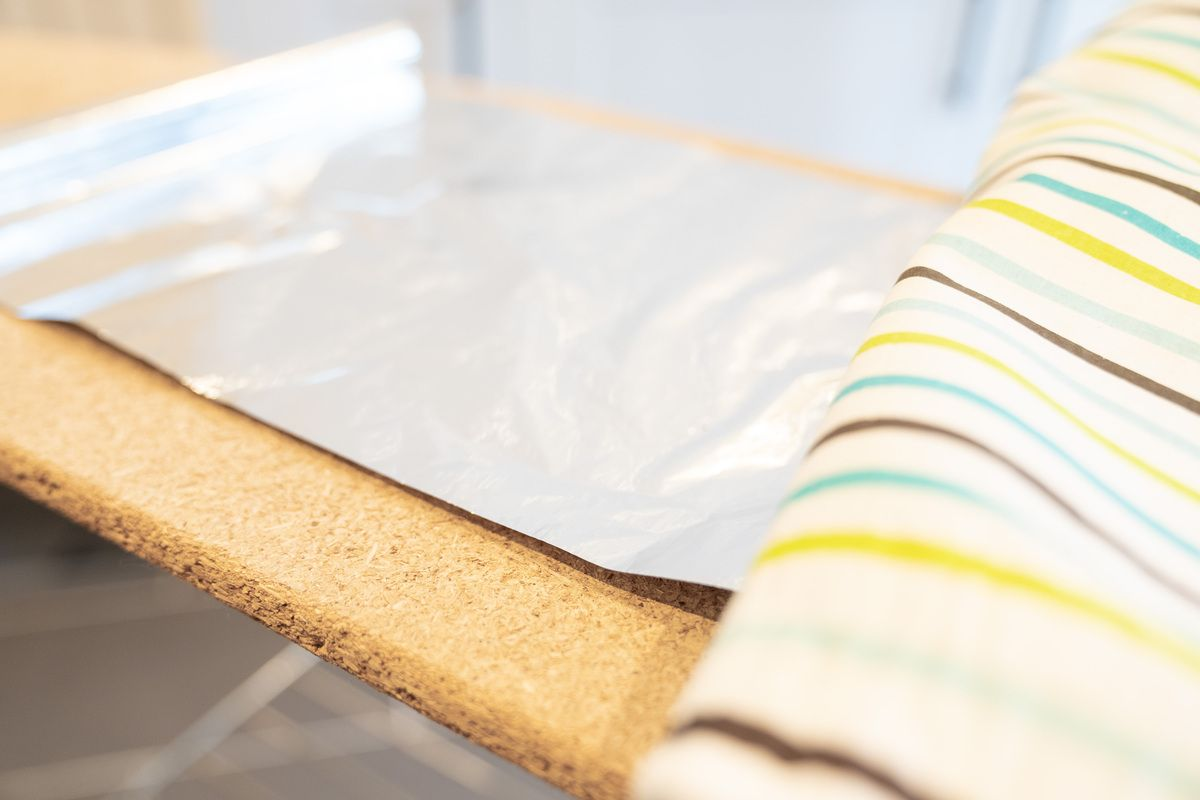 Using tinfoil under an ironing board cover