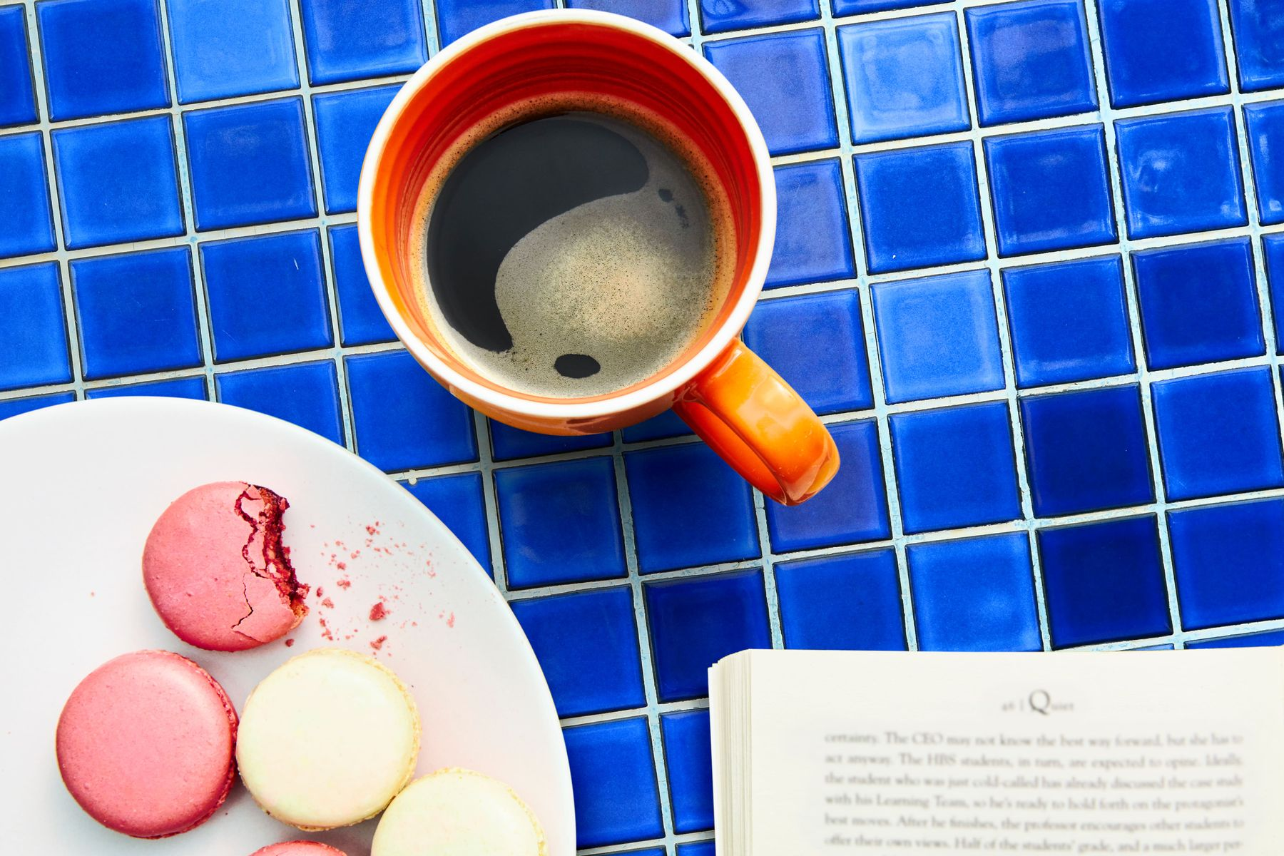 how to clean tiles: cup of coffee and macaroon on blue ceramic tiles