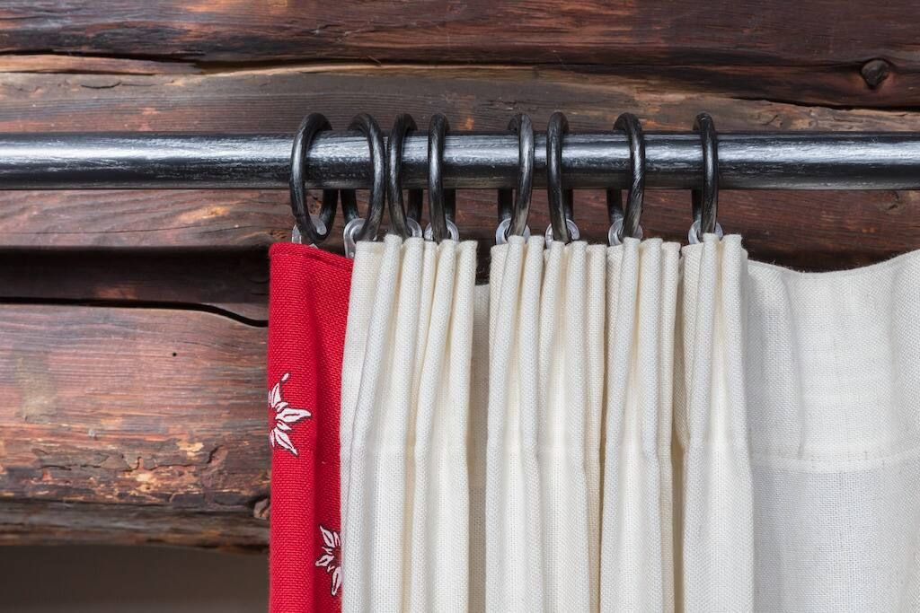 How to hang curtains with hooks and rings: curtain on a rail