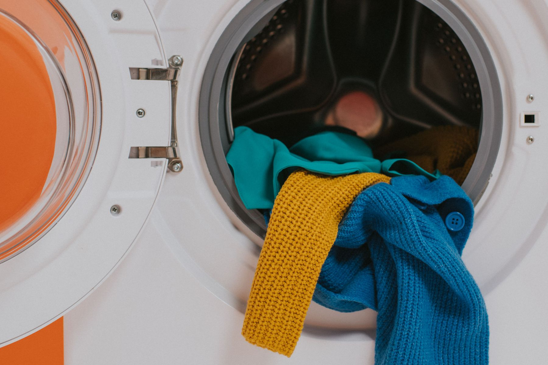 colorful clothes inside the washing machine