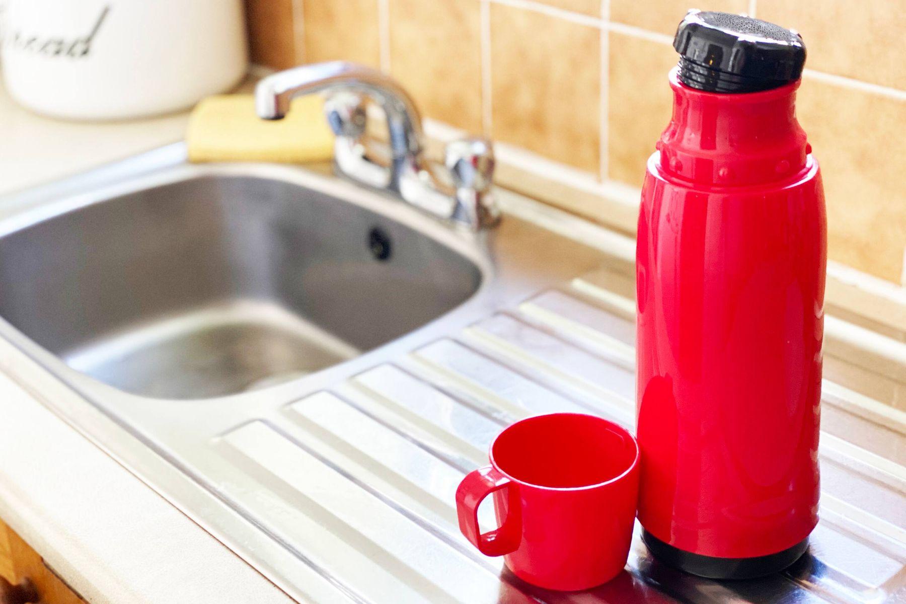 A flask beside a kitchen sink