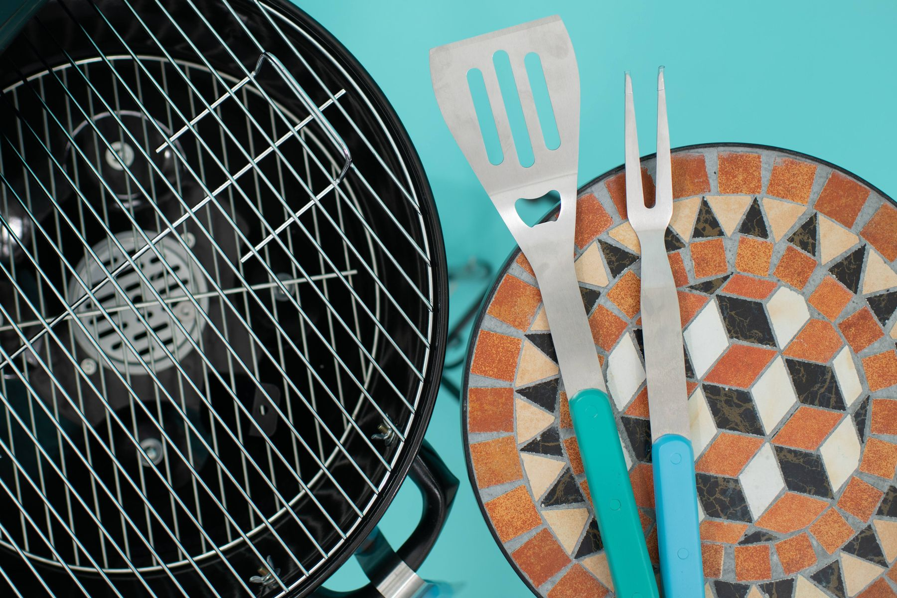Barbecue and barbecue tools on mosaic table for barbecue cleaning tips