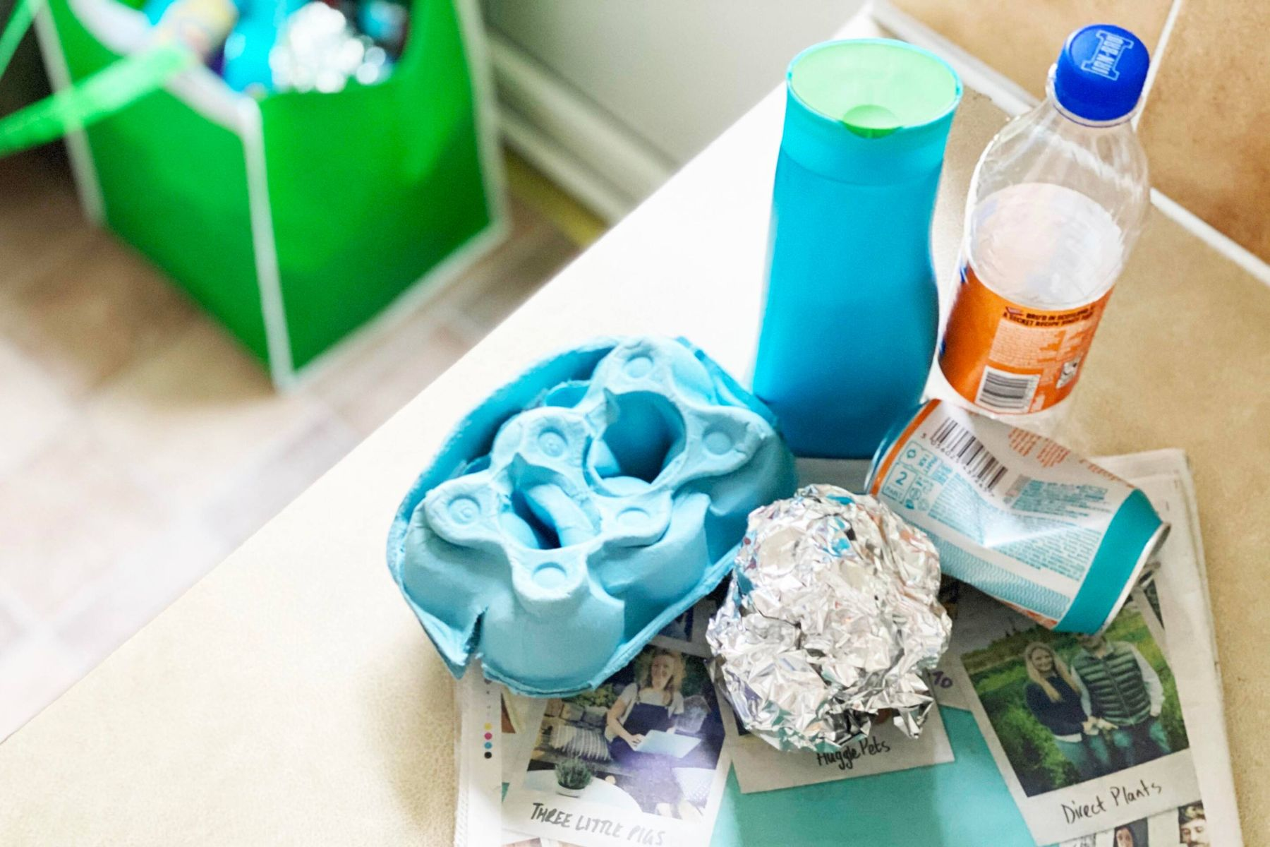 An egg carton, shampoo bottle, plastic bottle, drinks can, tinfoil and newspaper