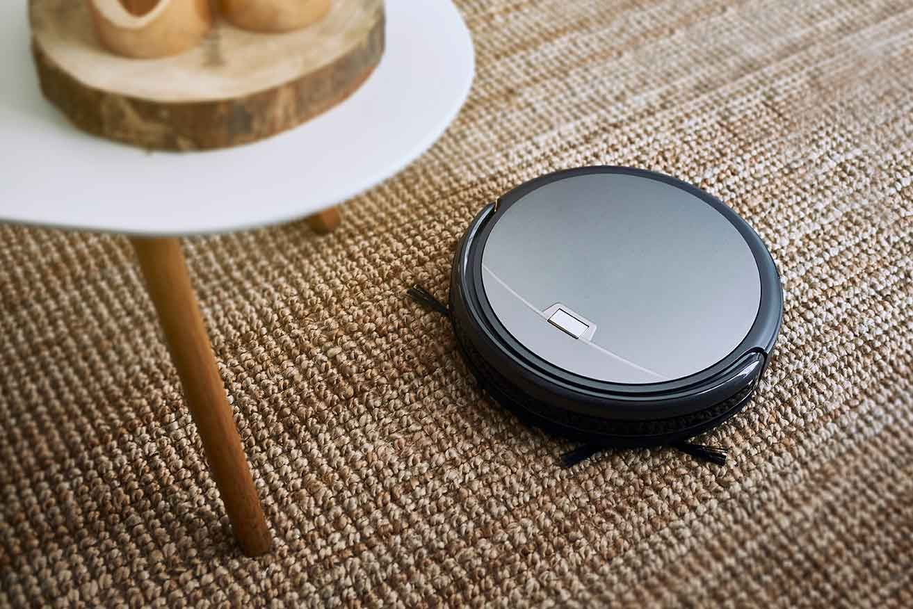 Robot vacuum cleaner cleaning a carpet