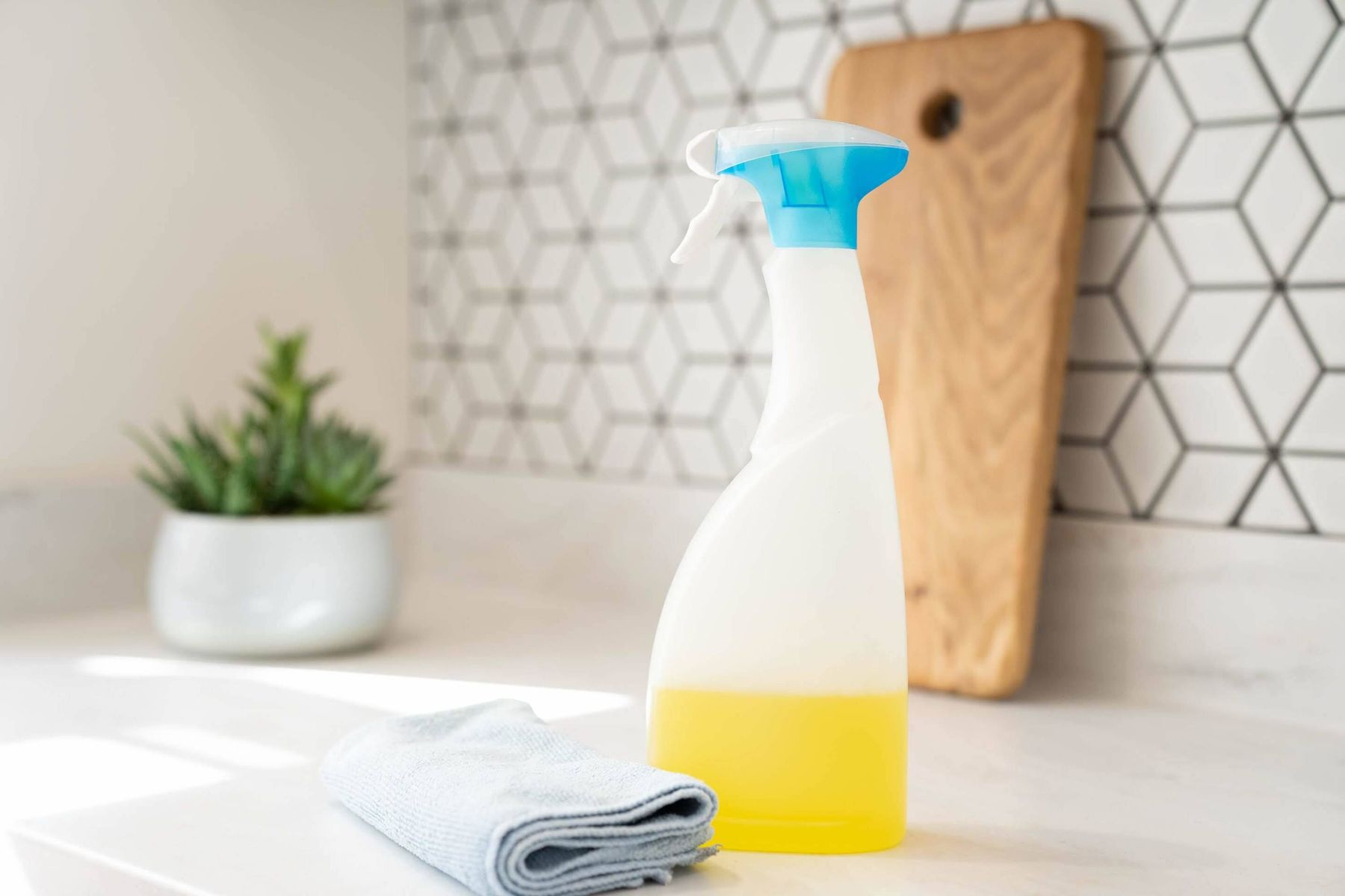 cleaning spray and cloth on the kitchen countertop