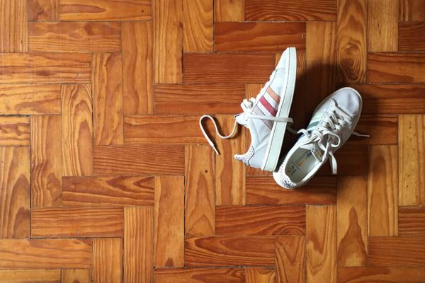 smelly shoes on wooden floor