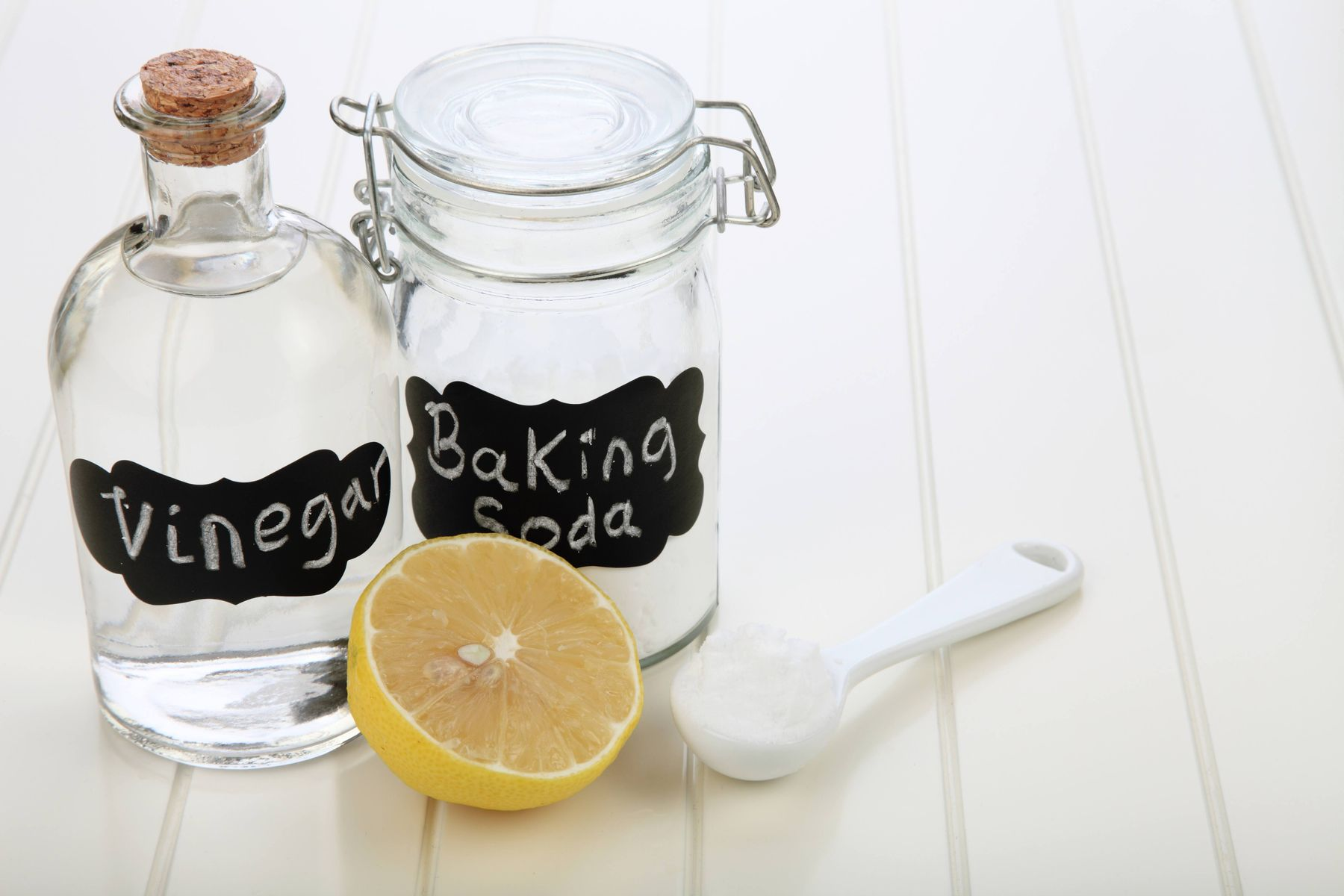 lemon vinegar baking soda on white table top
