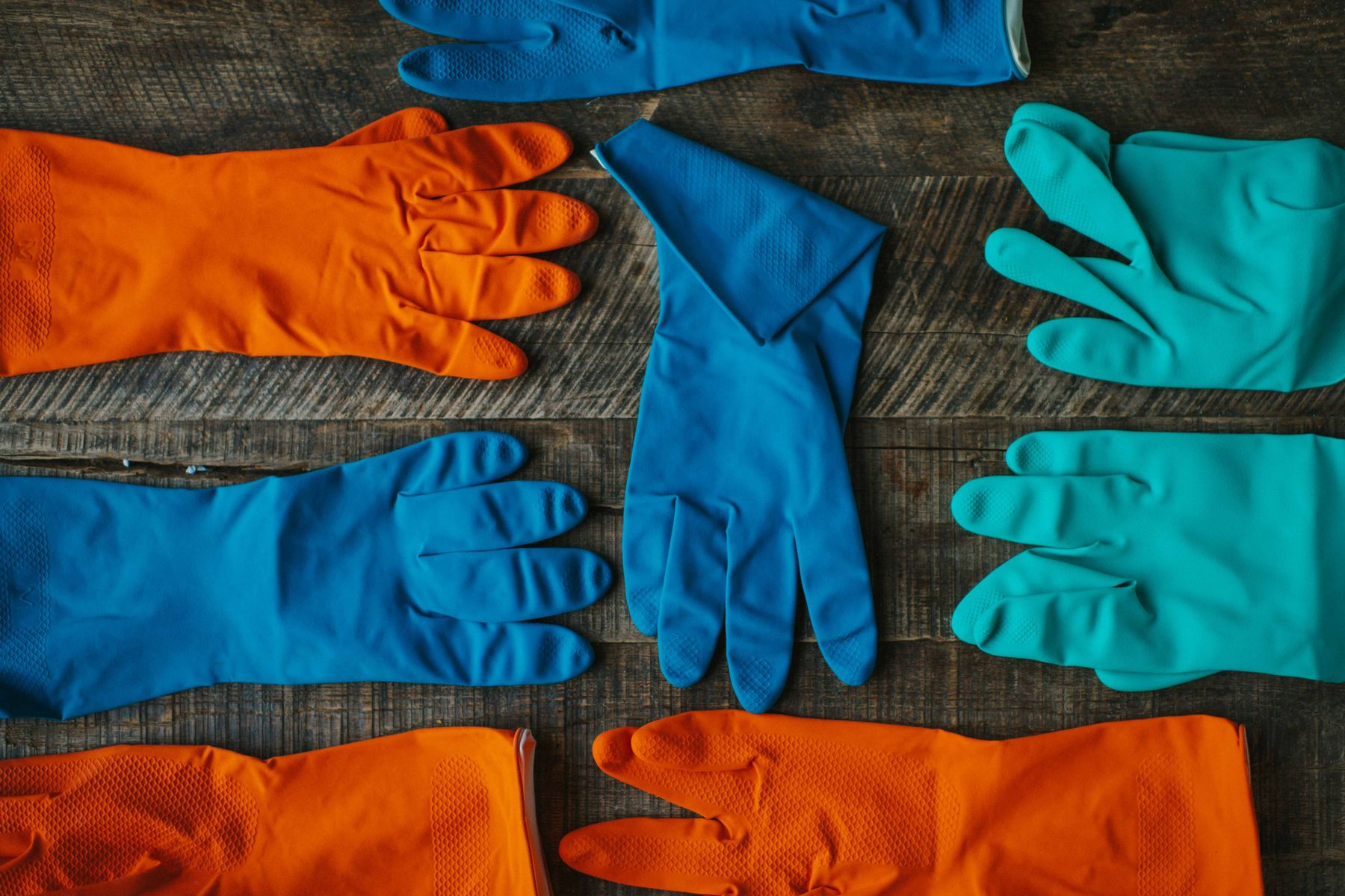 Rubber gloves in shades of blue and orange