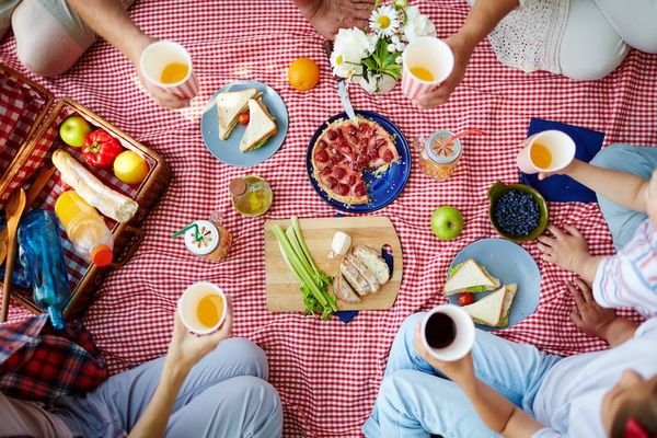 a red picnic spread with different dishes