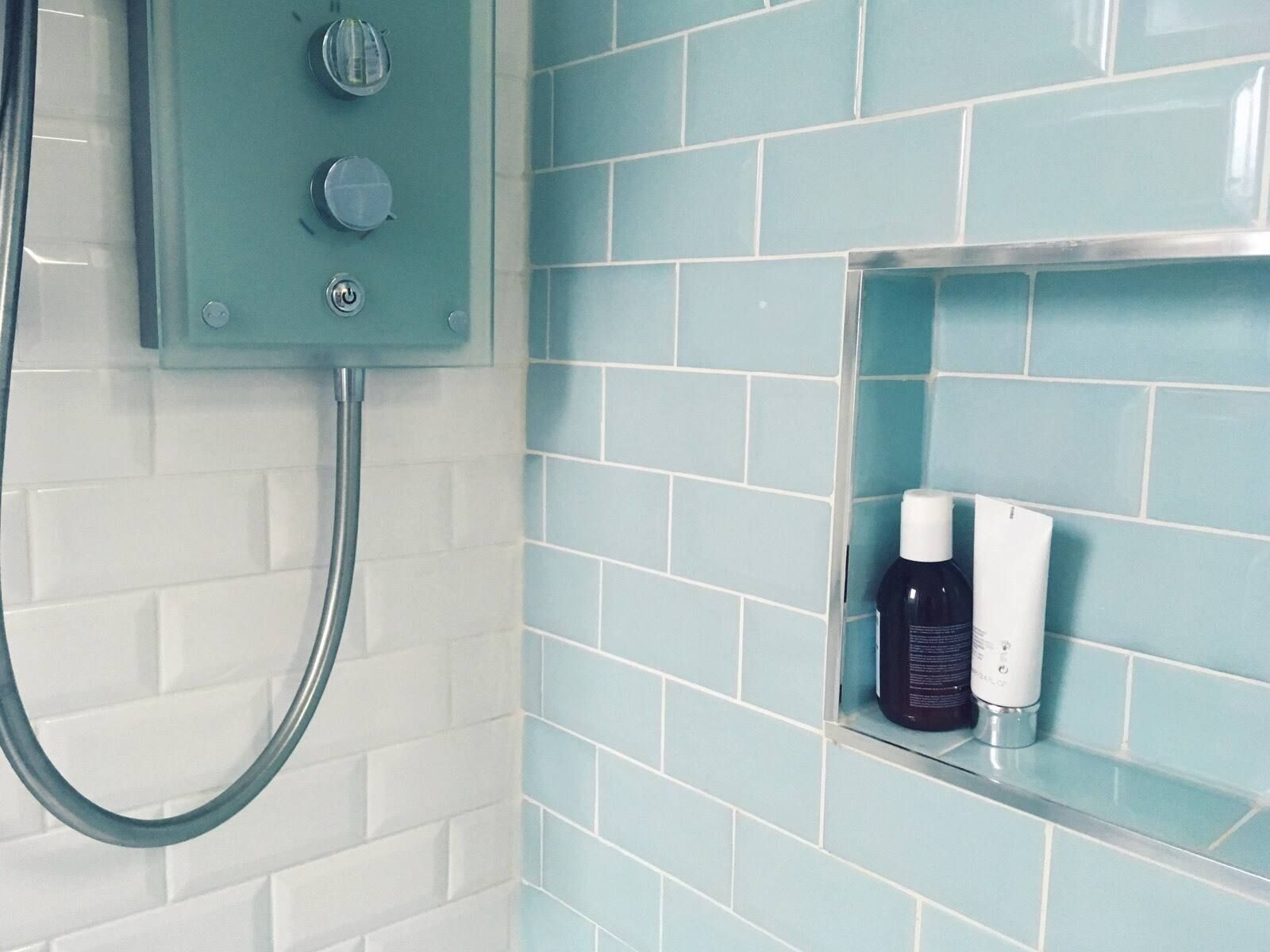 bathroom with blue and white tiles on the walls