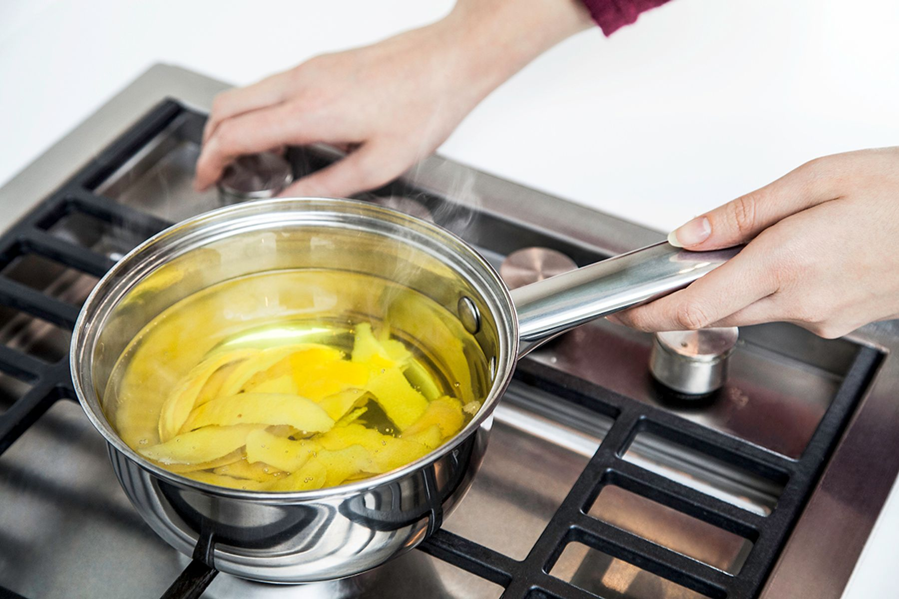 A pan of lemon skins boiling to fragrance a musty smelling house