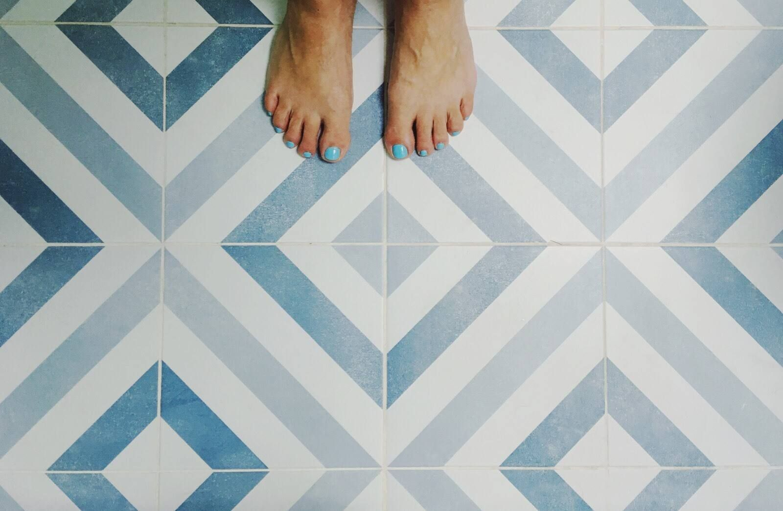 feet on a clean tiled floor
