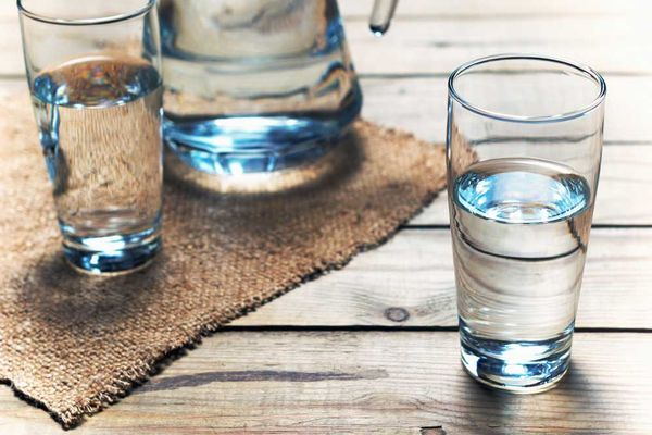Glass of water on a wooden  table