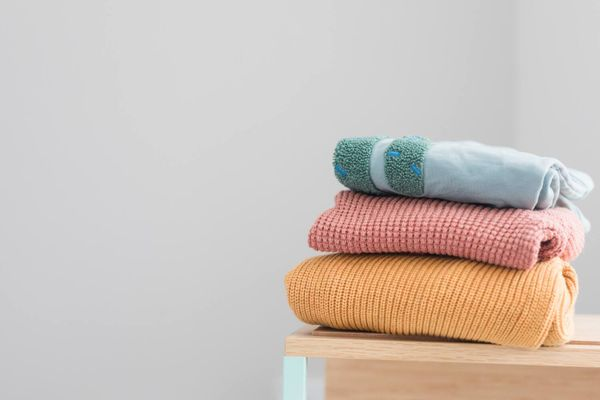A stack of colourful folded clothing