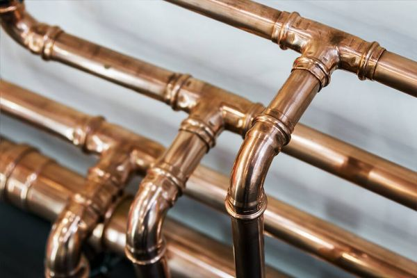 closeup of polished copper pipes
