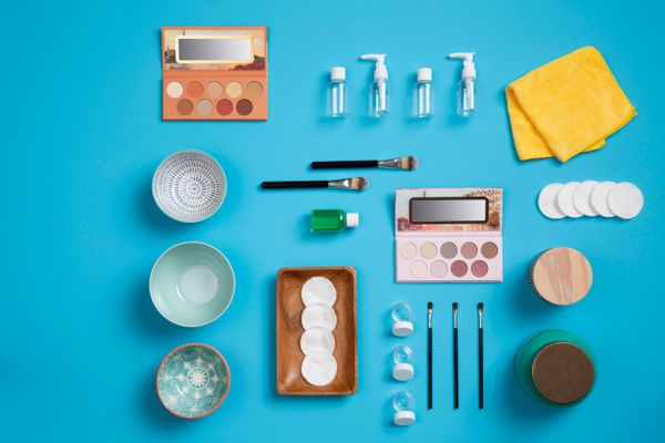 flatlay of make up and removing make up from clothes