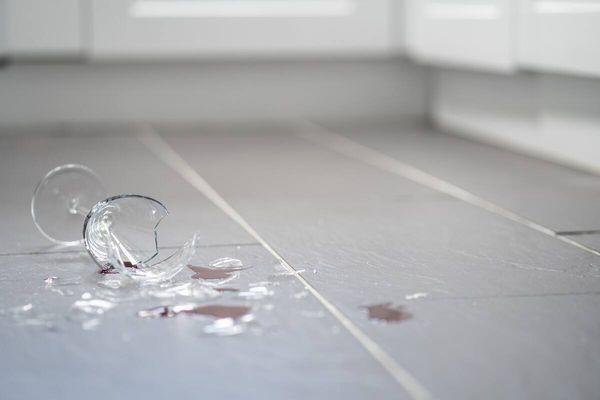 A broken wine glass on the floor