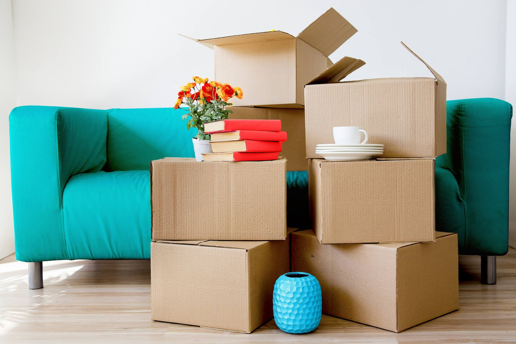 Moving in boxes on blue sofa