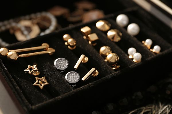silver and gold earrings displayed in an open jewellery box