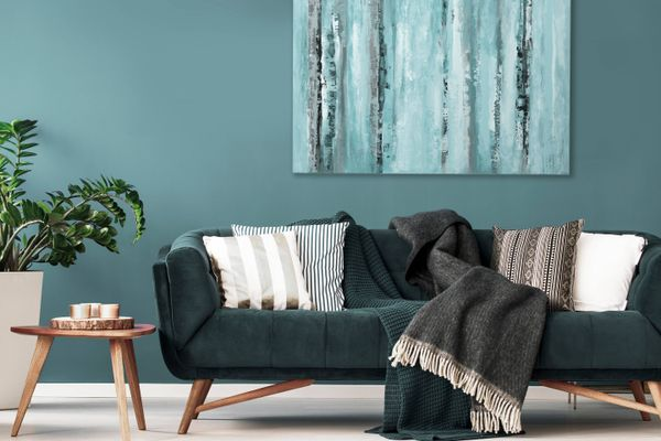a green couch in a blue living room