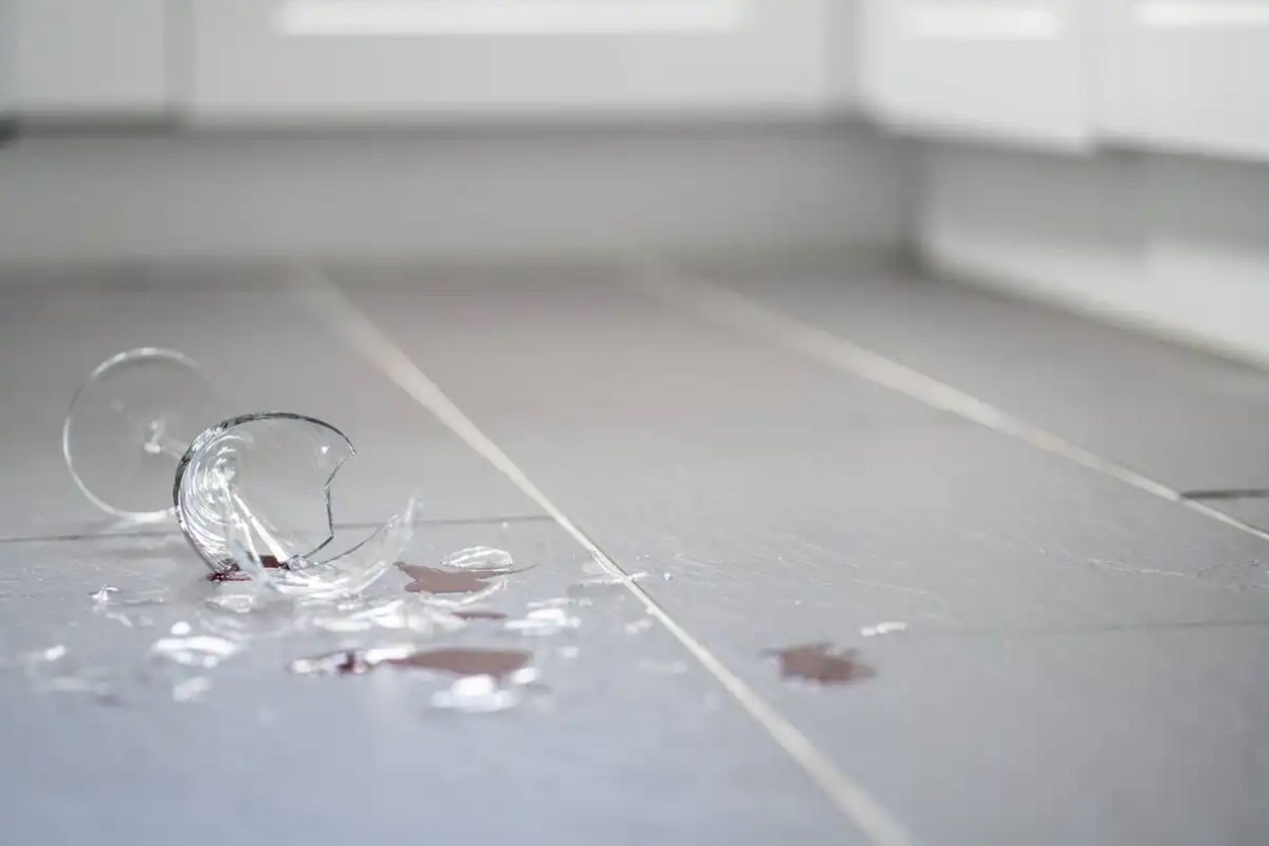 Smashed wine glass on the floor