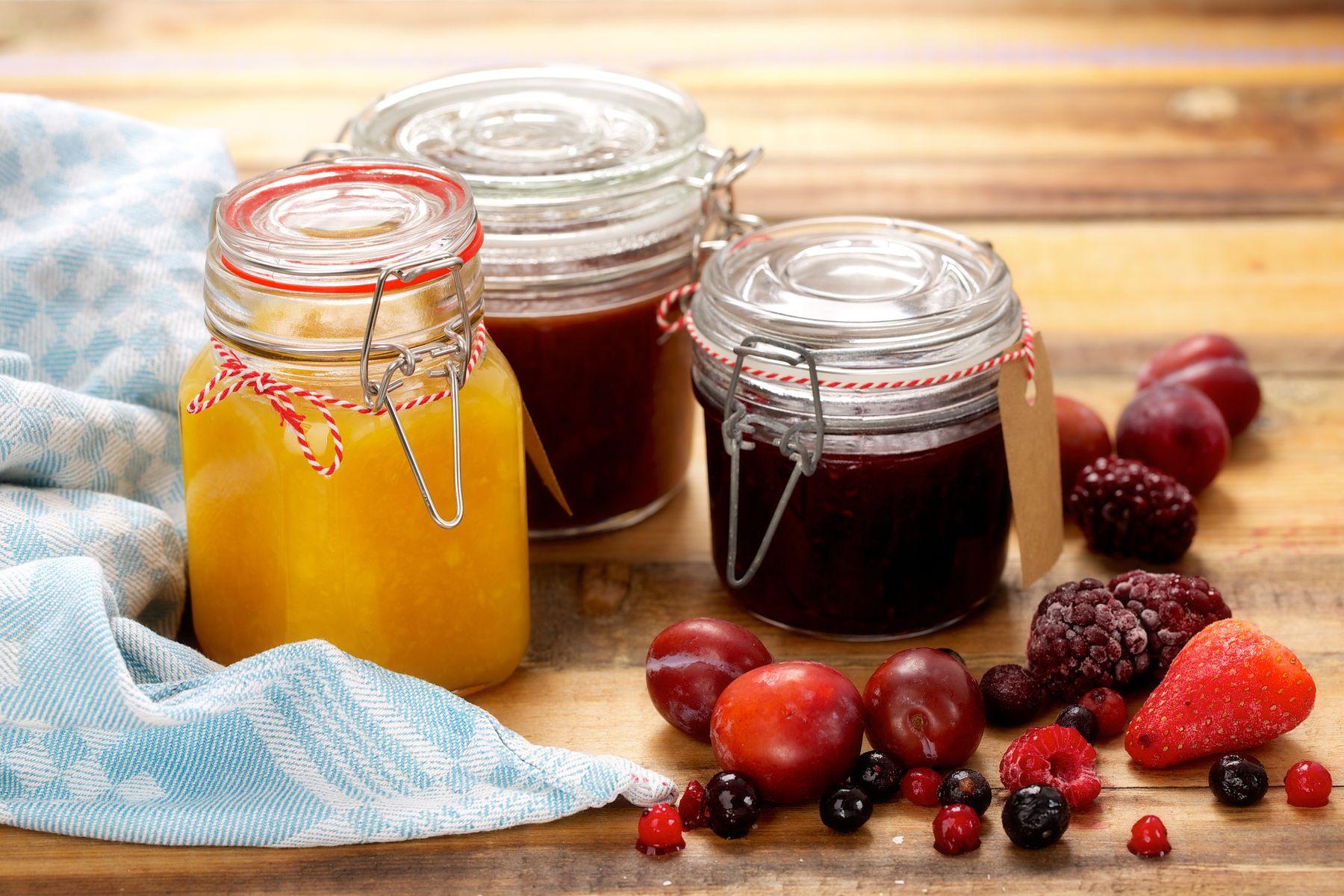 Three Kilner jam jars on a wooden table