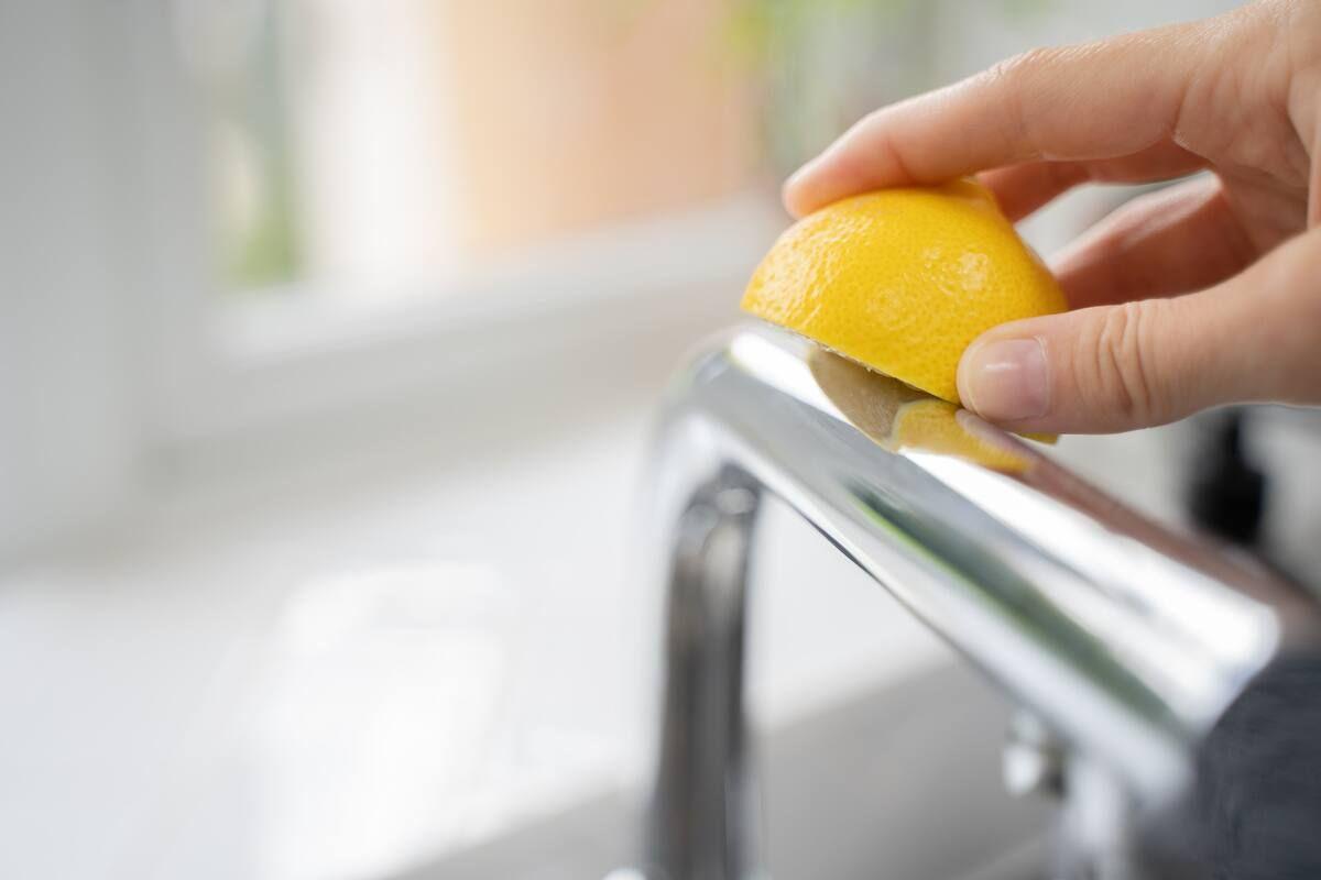 Rubbing half a lemon on a tap