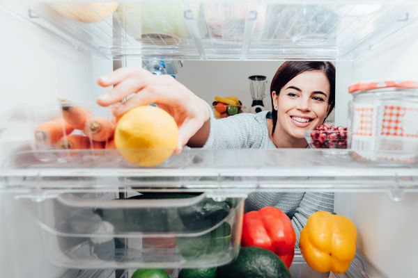 woman getting food from the fridge