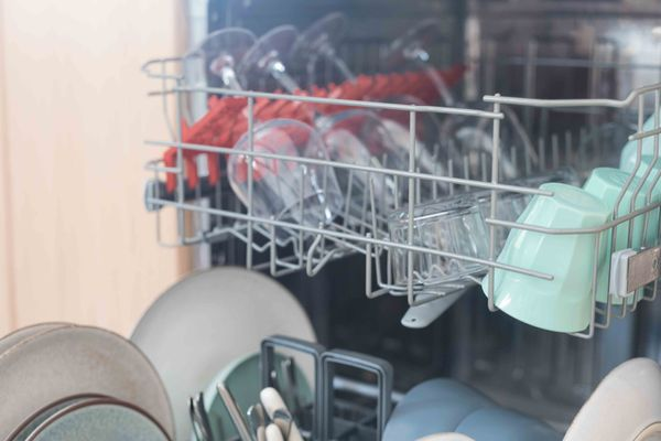 An open, loaded dishwasher