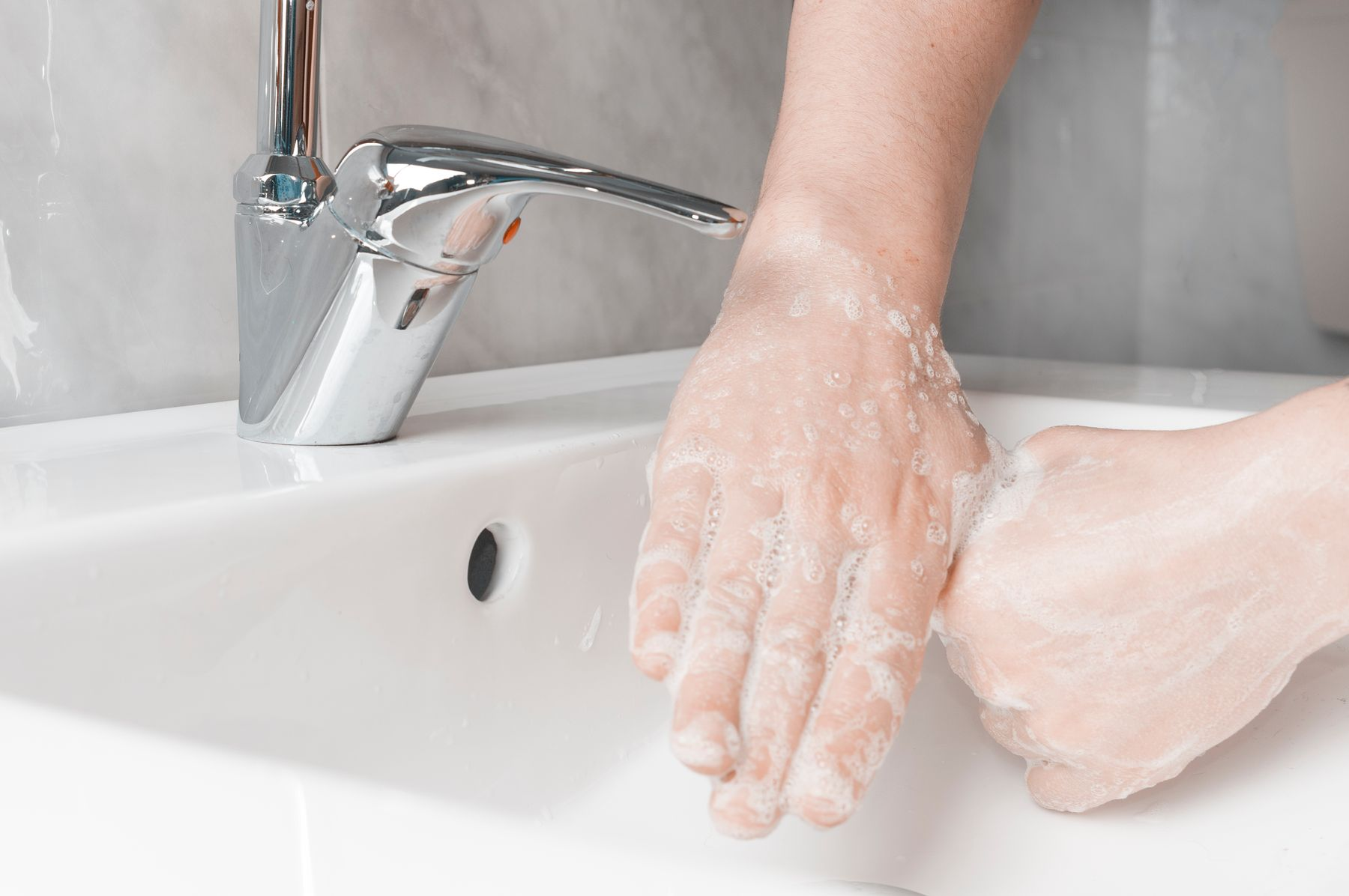 Step 3: person washing fingers for hand washing