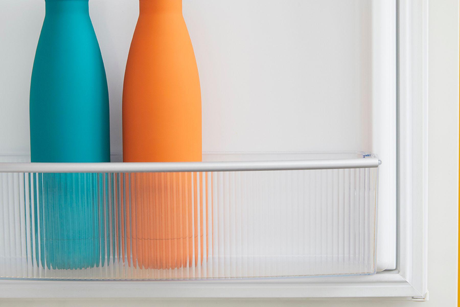 two water bottles in a fridge
