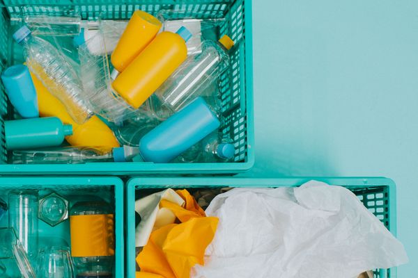 what can you recycle: plastic crates full of empty plastic packaging and rubbish