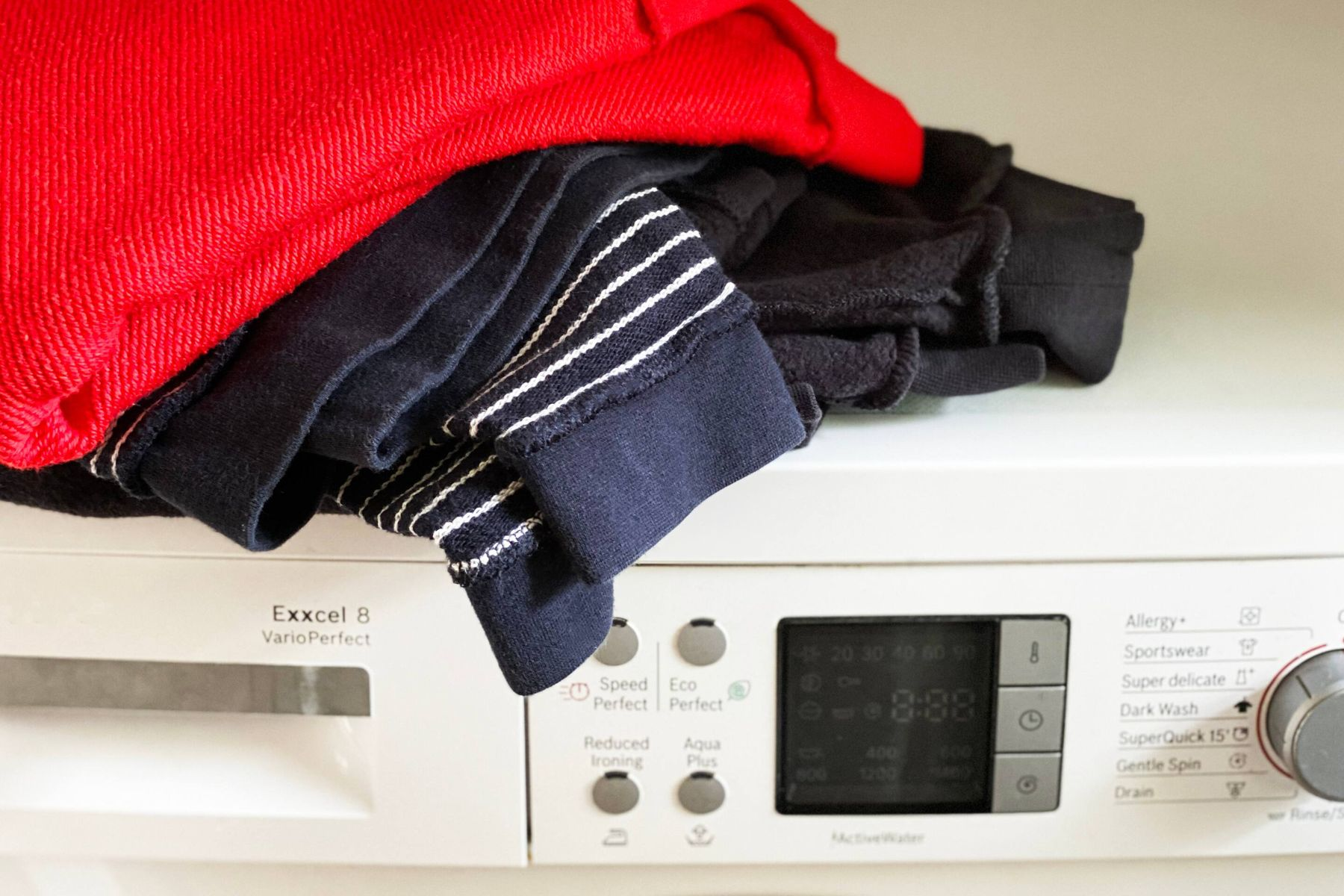 clothes on top of a wasching machine