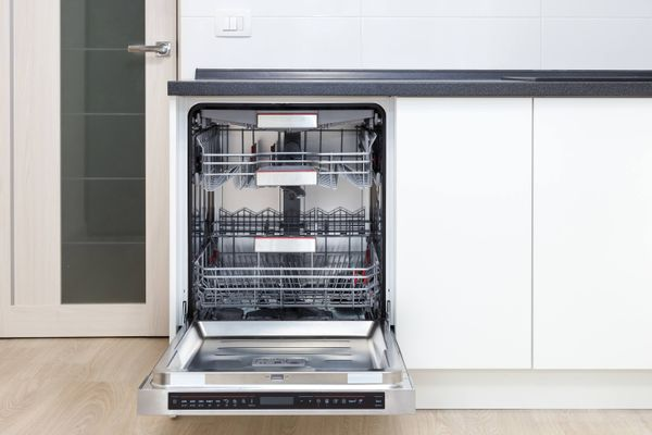 empty dishwasher in kitchen for cleaning