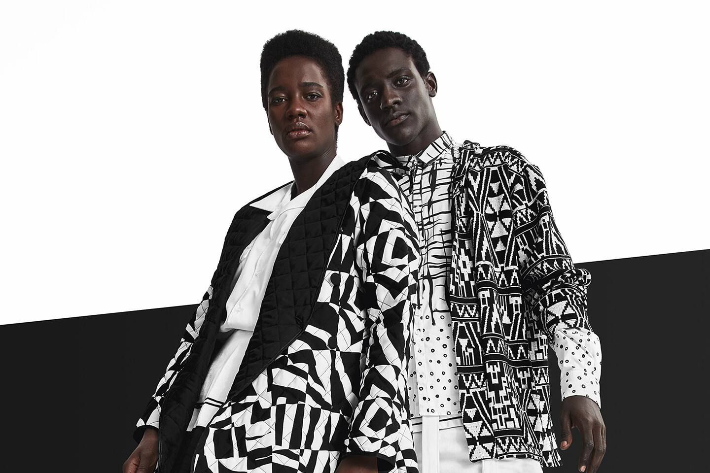 Two dark-skinned models and black and white geometric patterned jackets