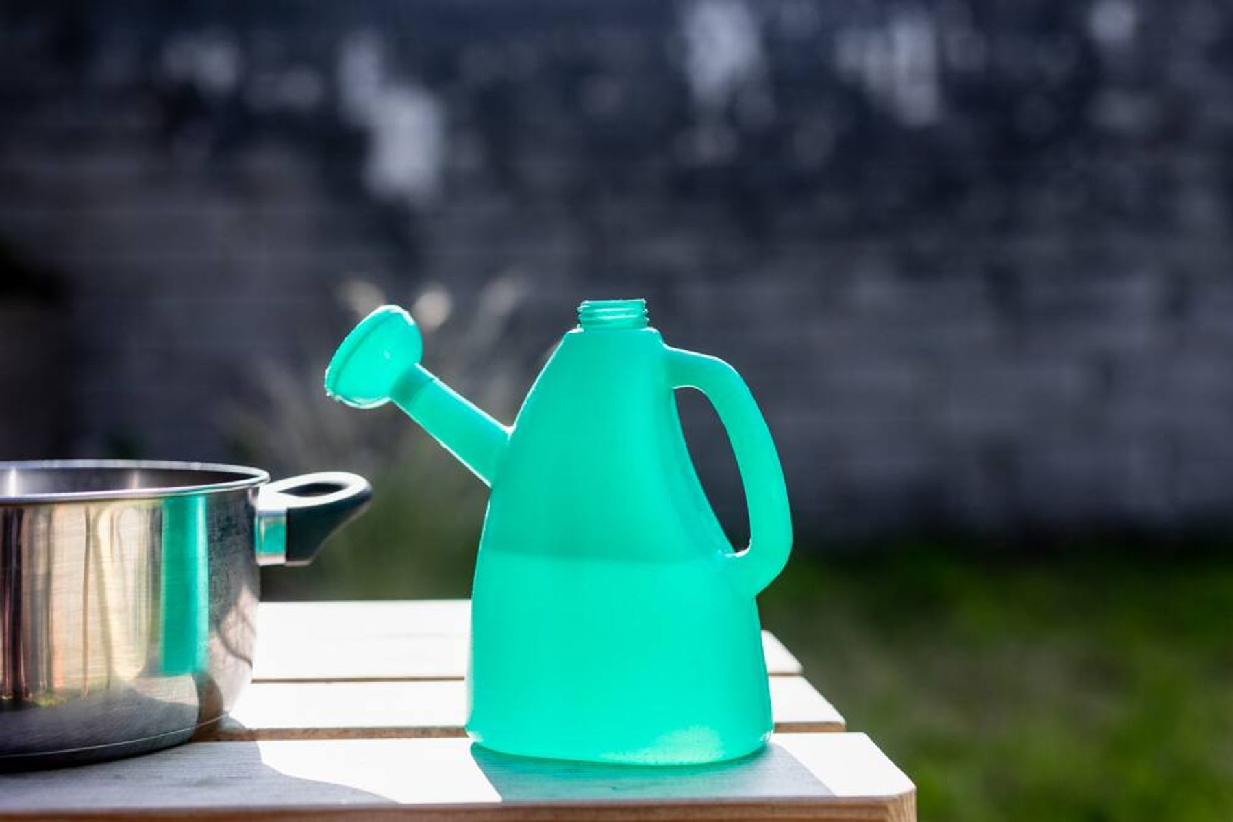 A pot beside a watering can
