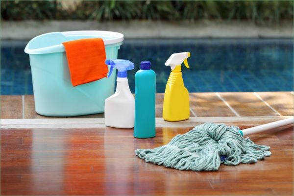 Assorted cleaning items arranged on the floor
