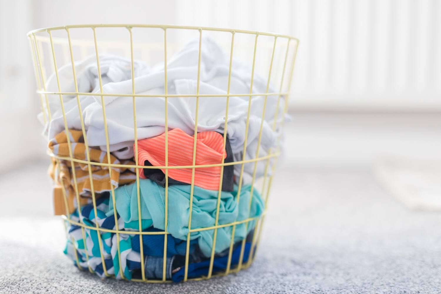 Laundry basket, with clothes separated by colour