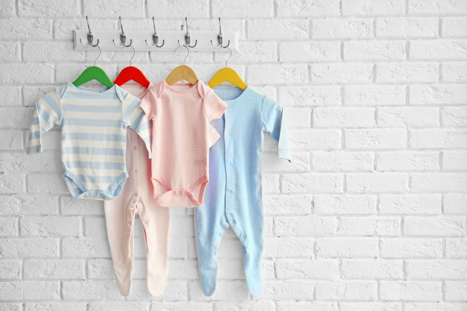 baby clothes hanging up