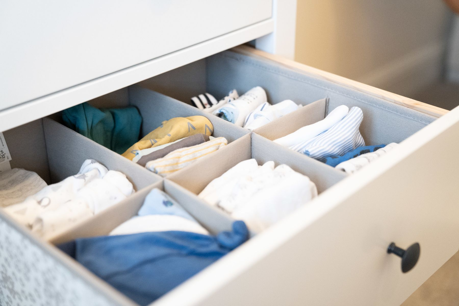 Open drawer containing linen