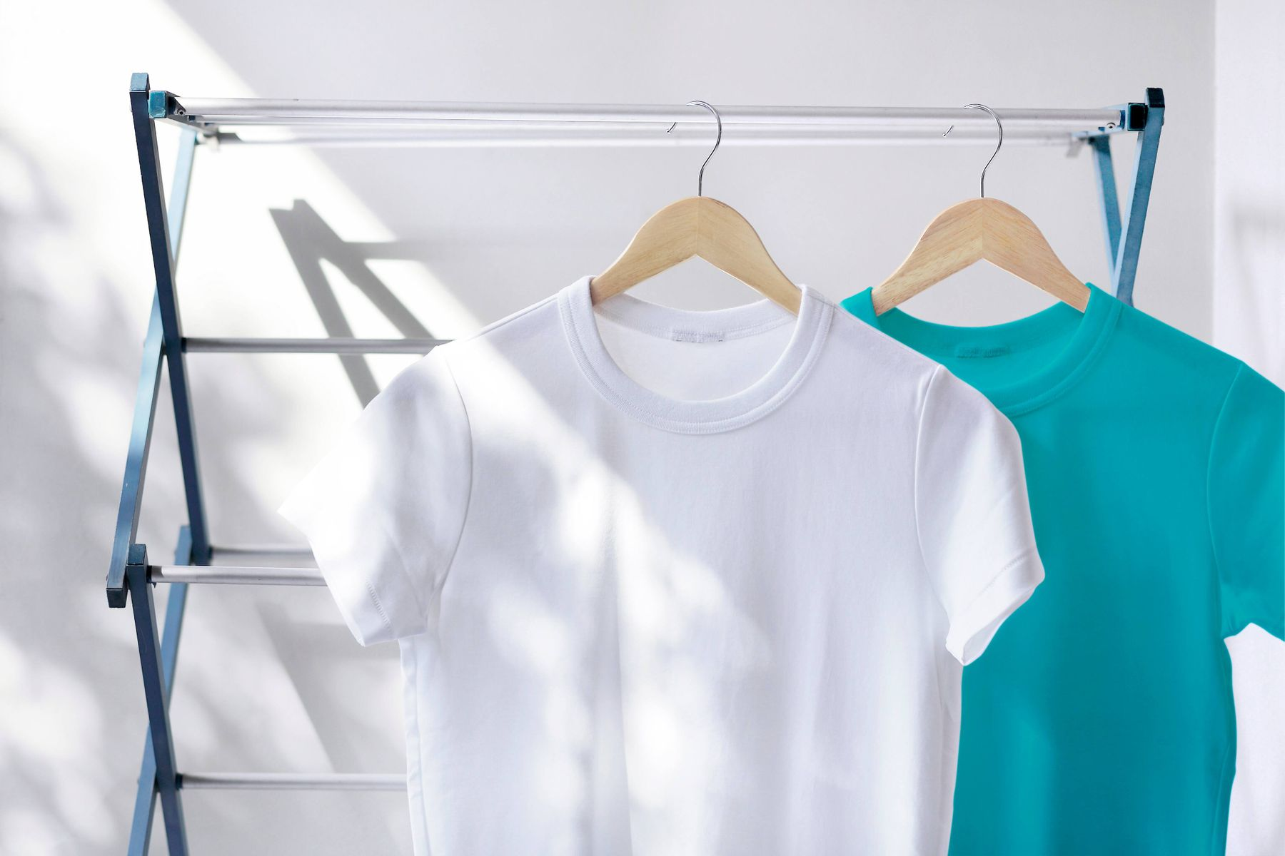 hanging t-shirts in drying rack