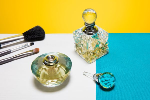 two-perfume-bottles-on-a-makeup-table
