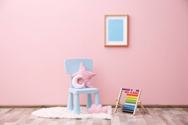 a blue painting on a pink wall