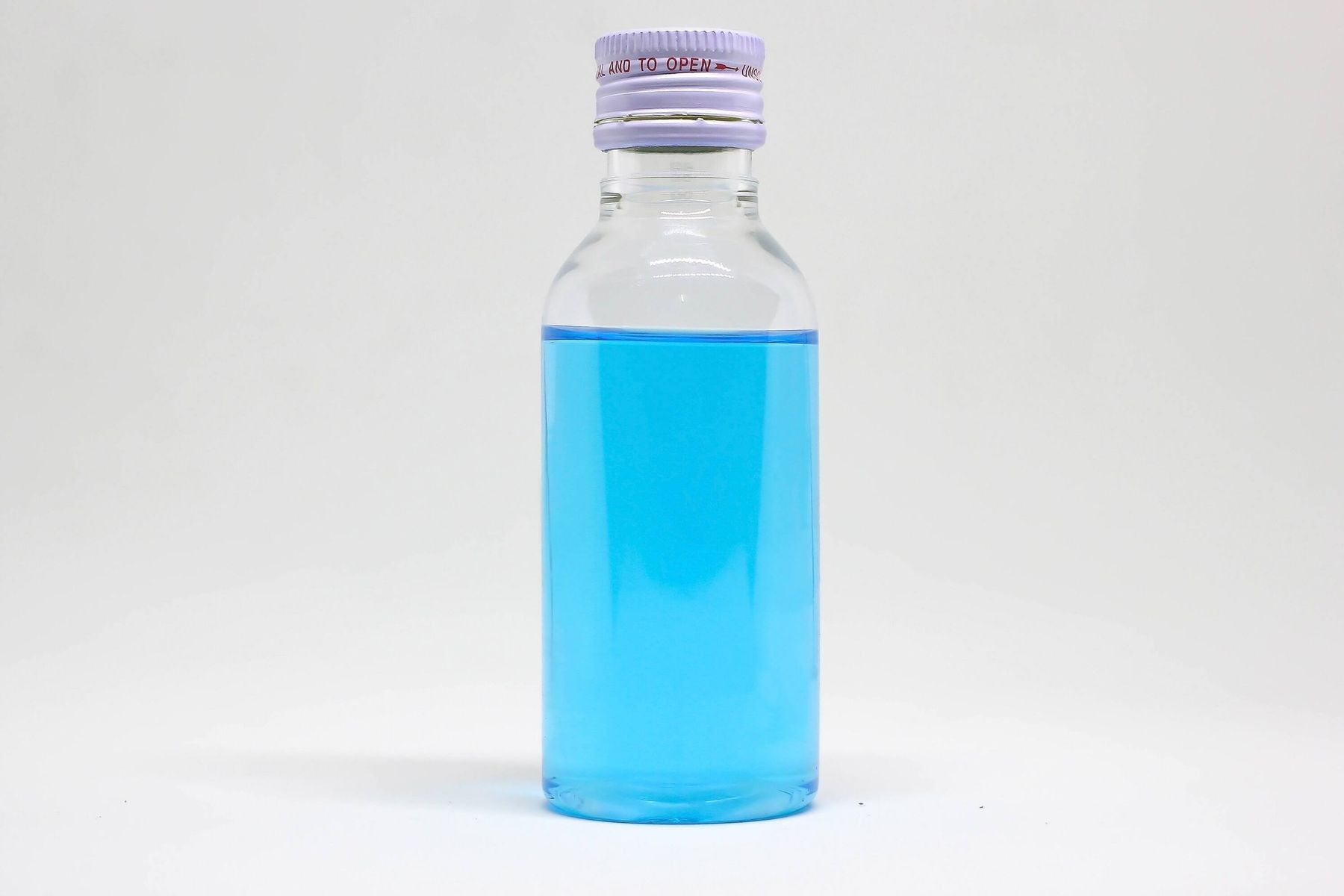 cleaning with rubbing alcohol: blue liquid in bottle